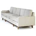 Style of dunbar fiveseat sofa upholstered in original black and white striped fabric on walnut base 29 x 125 x 32