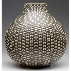 Axel salto  royal copenhagen large budding vessel covered in brown and gray flambe glaze featured on the front page of the style section new york times october 1999 incised salto stamped in