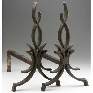 Raymond subes pair of castiron andirons of stylized flame design 15 34 x 9 x 15 34