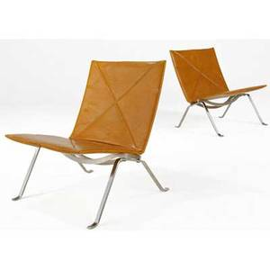 Poul kjaerholm  e kold christensen pair of pk22 lounge chairs covered in tan leather on steel bases impressed marks 28 x 25 x 25