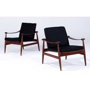 Finn juhl  france  son pair of teak lounge chairs with black fabric cushions france  son gold decal and metal tag 31 x 29 x 27
