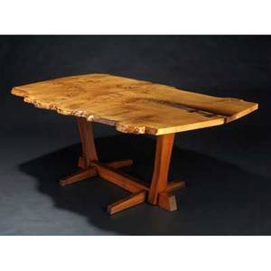 George nakashima conoid dining table its freeedge oak burl top with two rosewood butterfly keys on walnut base provenance available marked with clients name 29 x 76 x 43