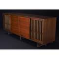 George nakashima walnut stereo cabinet with dovetailed case two wood doors and two grilled doors backed with pandanus cloth 1961 33 x 84 x 20
