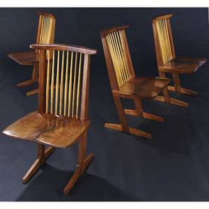 George nakashima set of four walnut conoid chairs with hickory spindles and onepiece figured crotchwalnut seats 1979 provenance and original invoice available marked with clients name 36 x