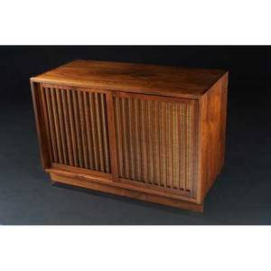 George nakashima walnut credenza its two grass clothbacked grilled doors enclosing two drawers 28 12 x 22 x 20