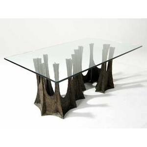 Paul evans sculpted bronze dining table with plate glass top resting on a serpentine stalagmite base 28 34 x 72 x 44