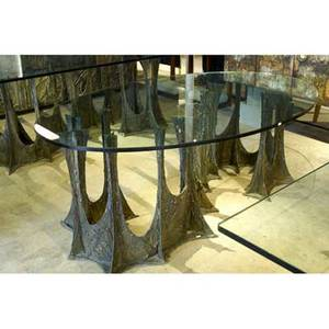 Paul evans sculpted bronze dining table with an elliptical plate glass top on a serpentine stalagmite base 1972 signed pe 72 26 34 x 72 x 37 34