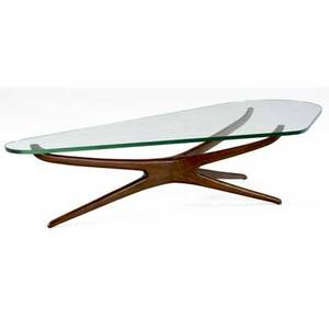 Vladimir kagan trisymmetric coffee table with biomorphic plate glass top on sculpted walnut base 16 x 69 x 34