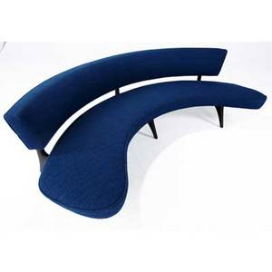 Vladimir kagan curved floating sofa upholstered in indigo wool on sculpted walnut frame 27 12 x 90 x 28 12