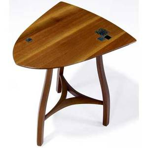 Edward wormley  dunbar sculpted walnut side table its top inset with tiffany favrile glass tiles dunbar brass tag 25 x 19 12 x 15