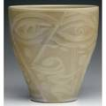 Rudy staffel vase decorated with an abstract face in taupe glaze with embossed decorations signed rudy staffel 7 34 x 7 34