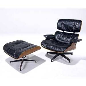 Charles and ray eames  herman miller rosewood lounge chair and ottoman with black leather upholstery 32 x 33 x 30