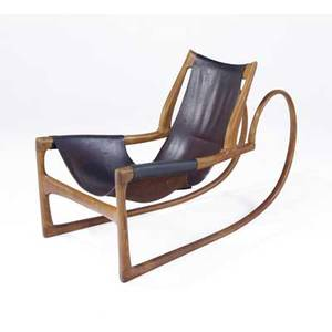 Wendell castle early and important sculpted oak sleigh chair with hard leather sling seat 1963 an early masterwork by wendell castle the piece expertly combines the sleekness of american industria