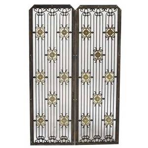 Singer building new york 190608 pair of wroughtiron grilles with gilded floral medallions the singer building was the worlds tallest structure from 190809 before the metropolitan life insuran