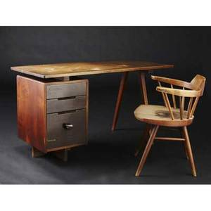 George nakashima early and rare walnut singlepedestal threedrawer desk with bitter root pull together with an armhair provenance available desk 28 x 52 x 23 34 chair 28 x 23 12 x 17