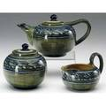 Newcomb college early threepiece tea set painted by mary sheerer with banded leaf and pod design in blue green and ivory on a green ground 1907 chip to inner rim of lid nick to spout of tea pot