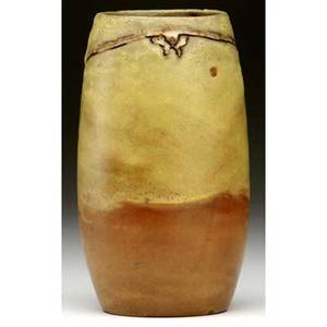 Rhead  santa barbara vase decorated with a large bird in flight incised and glazed white against matte yellow and brown ground yshaped line around body overfiring bubbles circular stamp 6 x 3