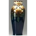 Rorstrand porcelain vase decorated by nils lindstrom with large reticulated ivory blossoms and brown stems against a cobalt ground small flat chip at foot ring blue ink mark 14 34 x 6 14