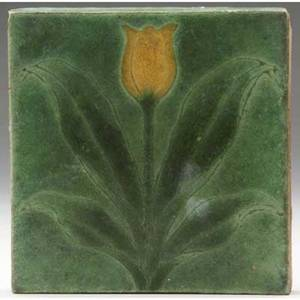 Grueby tile decorated in cuenca with a yellow tulip and green leaves on a green ground two corner chips marked ky 6 sq