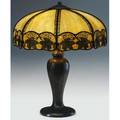 Handel table lamp its faceted shade of caramel slag glass with a band of applied oak leaves over a threesocket base decorated with tall leaves and buds base stamped handel 24 x 18