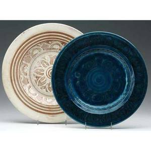 Marblehead two chargers one in persian blue with scrolled design 1926 the other ivory and brown with sunburst design from the collection of arthur baggs daughter mary trowbridge baggs tweet of