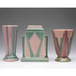 Roseville three pink and green futura vases one starshaped one flaring foursided and one foursided with buttressed handles and stepped neck restoration around base and small area of rim unmar