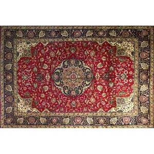 Persian tabriz roomsize rug with a large floral multicolored medallion on a rich ruby field ivory palmettes surrounded by a floral palmette border ca 1970 98 x 127