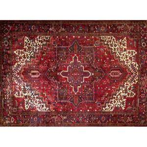 Persian heriz roomsize rug with a geometric medallion in ruby red olive and indigo on a ruby field with ivory spandrels and an unusual border ca 1970 9 x 11