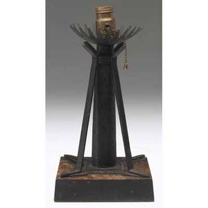 Roycroft rare and early wroughtiron lamp base with buttressed shaft on wooden base a similar example dated 1901 can be seen in head heart and hand elbert hubbard and the roycrofters by marie