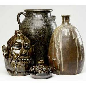 North carolina pottery four pieces lanier meaders face jug mary rogers face jug large stoneware jug with loop handle unidentified stoneware vase with white drip glaze meaders jug signed tallest
