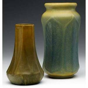 Van briggle two vases one with tall pointed leaves covered in browngreen glaze the other slightly corseted with rounded leaves under textured bluegreen and yellow both marked 5 12 and 7 14