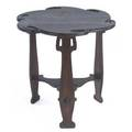 Charles rohlfs carved tea table with a floriform top over three legs and lower shelf unmarked 26 x 26 dia