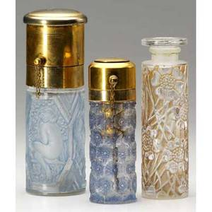 R lalique three perfumes of clear and frosted glass les cinq fleurs for forvil with sepia patina c 1924 sussfeld with blue patina c 1926 and one for corday with figures and flowers in blu