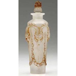 Rene lalique pan perfume bottle of clear and frosted glass with sepia patina c 1920 molded r lalique engraved lalique m p 332 no 504 5