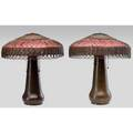 Gustav stickley pair of hammered copper foursocket lamp bases topped by wicker and red fabric shades unmarked 23 x 18 12 each