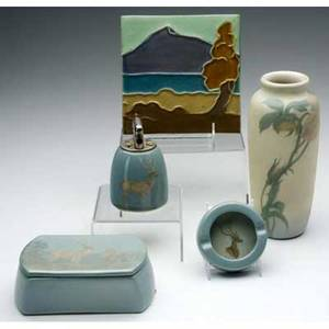 Rookwood five pieces late iris glaze set of covered box ashtray and lighter painted with bucks 1948 vellum vase painted by ed diers with leafy branch of pink flowers 1905 extensive restoration