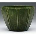 Grueby flaring jardiniere with tooled and applied rounded leaves covered in a rich curdled matte green glaze very crisp several very small nicks to edges one filledin circular pottery stamp 4