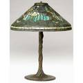 Tiffany studios exceptional table lamp its poppy shade resting on a spectacular twisted vine threesocket bronze base exhibited in amercan arts  crafts from the collection of alexandra and sidney