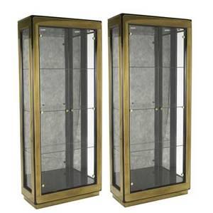 Mastercraft pair of bronzeclad and glass vitrines illuminated interiors and three adjustable shelves each bronze mastercraft tag 84 12 x 36 14 x 16