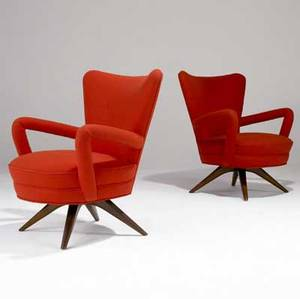 Vladimir kagan two armchairs with bright orange wool upholstery on sculpted walnut bases 33 12 x 26 12 x 22 12