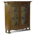 English arts  crafts bookcase with inlaid leadedglass doors 47 x 46 x 13
