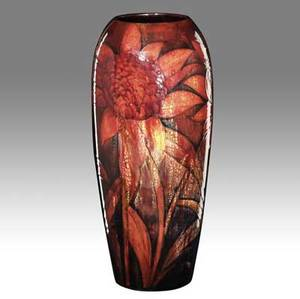 Moorcroft tall and rare red flambe vase with blossoms 1939 some underglaze mottling to one area stamped moorcroft potter to hm the queen green ink signature and date 17 x 7