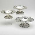 Three belle epoque american silver compotes all having pierced and chased borders and pedestals one with floral engraved bowl by bailey banks  biddle co 8 34 x 3 12 a pair with undulating ri