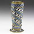 Russian enameled giltsilver beaker by antip kuzmichev moscow 88 silver ca 1895 tapered cylindrical vessel on circular foot decorated by borders and spiraling ribbons of cloisonne enamel in variou