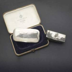 Two russian silver boxes ca 18801890 cased tobacco box by pavel sazikov with imperial warrant st petersburg 84 standard 4 14 x 2 14 scenic niello decorated snuff box moscow 1883 84 stan