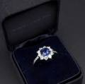 Fine tiffany  co blue sapphire and diamond ring platinum designed as a circular cluster cushion shaped sapphire 66mm x 68mm approx 150 cts surrounded by eight brilliant cut diamonds and di