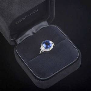 Important tiffany  co diamond  sapphire ring rectangular cushion cut blue sapphire approx 450 cts 968mm x 883mm x 647mm framed by a line of circular cut diamonds to shoulders of graduate