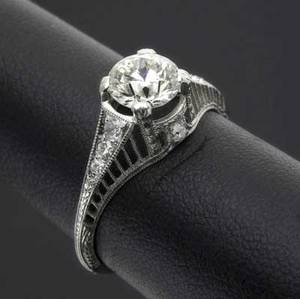 Art deco diamond ring platinum filigree with fine transitional cut diamond approx 80 ct in pierced setting with diamond accents and chased details size 5 34
