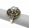 Late art deco pearl and diamond ring 14k yg and platinum circular handmade ring spherical pearl 8mm surrounded by eight bezelset transitional cut diamonds diamond shoulders 109 gs size 6