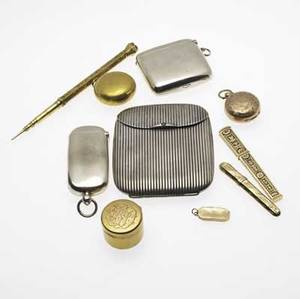 Victorian gold and silver accessories ten pieces english silver double compartment vesta case with 14k and amber cigar holder english silver vesta casesovereign holder 900 silver cigarette case wi
